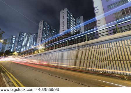 Light Trail Of Traffic In Urban City At Night