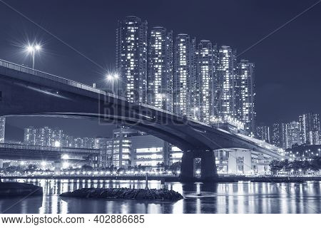 High Rise Residential Building And Bridge In Hong Kong City At Night