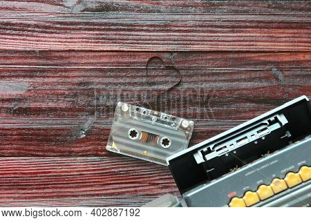 The Cassette Tape With Radio Cassette Player On Brown Wood Table