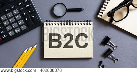 Notepad With Inscriptions B2c On A Grey Background With Office Tools . Business