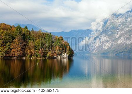 Bohinj is an alpine lake of glacial origin in the Julian Alps. Magnificent lake with clear clear water is surrounded by mountains and dense forests