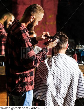 Haircut Concept. Hipster Client Getting Haircut. Man Visiting Hairstylist In Barbershop. Barber Work