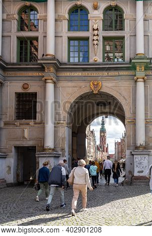 Gdansk, Poland - Sept 6, 2020: People At The Ornate Golden Gate Where The Long Lane Starts At The Ma