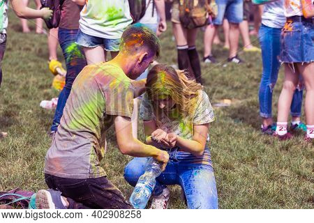 Krasnodar, Russia - May11,2018: Festival Of Colors, Traditional Indian Festival Of Holi. Young Peopl