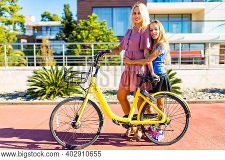Parent Teaching Child To Drive On Bike Tropical Beach
