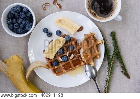 Belgian Waffles With Honey, Blueberries, Banana And Almonds