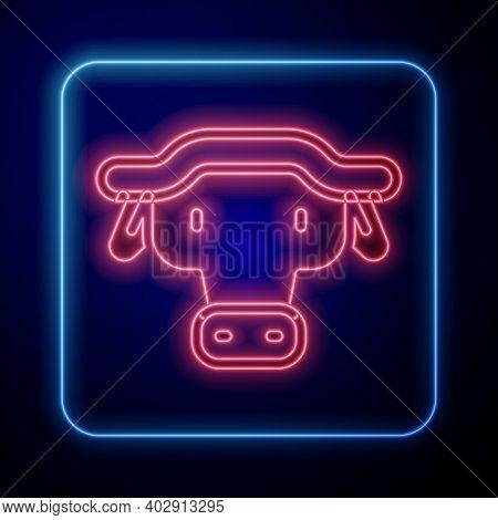 Glowing Neon African Buffalo Head Icon Isolated On Blue Background. Mascot, African Savanna Animal.