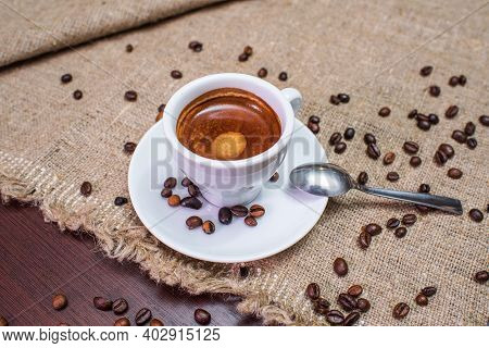 Delicious, Aromatic And Refreshing Espresso With Coffee Beans And Water