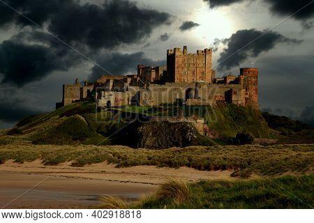 Bambergh Castle On The East Coast Of Northumberland. Uk. Sky Added.