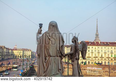 Holy Mother And Angel Statue In Turin , View From Catholic Parish Church Gran Madre