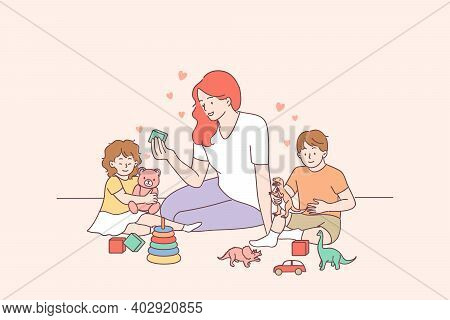 Playing With Children, Nanny, Mother Concept. Young Smiling Woman Teacher And Happy Toddlers Childre