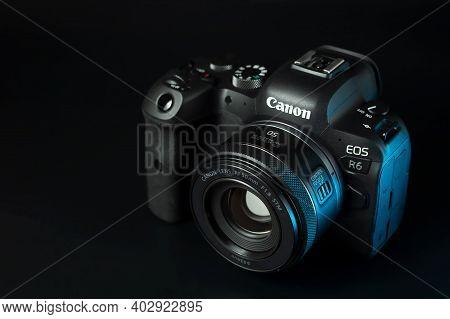 Canon R6 Digital Camera Close-up, Black Background, Glare