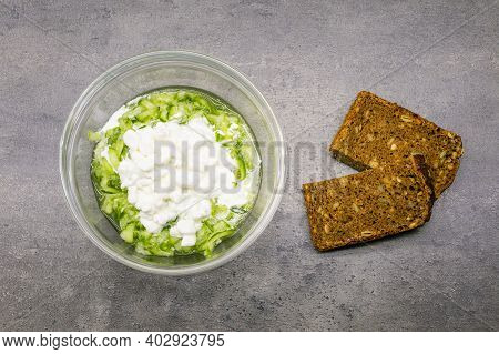 Cucumber Salad With Cottage Cheese And Wholemeal Bread. Heathy Vegetarian Snack