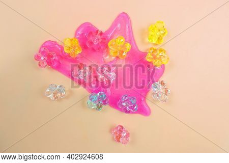 Pink Neon Slime And Glass Flowers Decorative Elements.  Liquid Art Gel Background. Abstract Textured