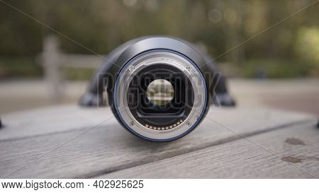 Details Of The Camera Lens With Opened Aperture, Close Up View. Action. Camera Lens On A Wooden Rota