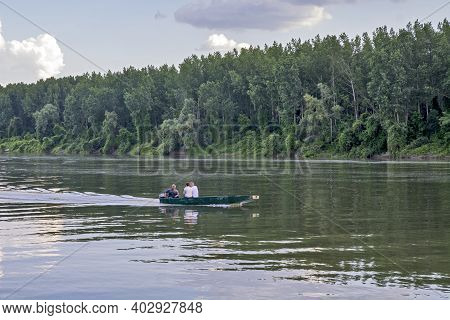 Tisa River, Serbia, June 07, 2020. Sailing In An Old Fishing Boat Of Excursionists In The Middle Of