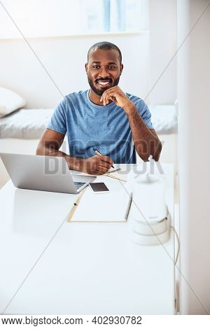 Joyful Businessperson Is Writing In His Notepad