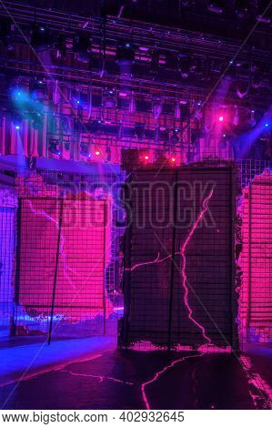 View From  The Backstage Of A Theater, A Red And Blue Lights Brakes Through The Decorations