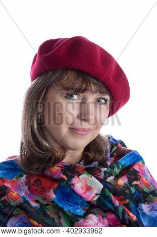 Smiling Middle-aged Woman Wearing Red Cap And Scarf Isolated On White Background