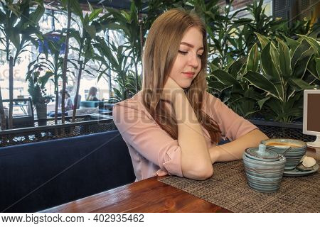 Side View Of Beautiful Lady Lond Blond Hair Looking At Sugar Bowl On Table. Copyspace Image Of Lass