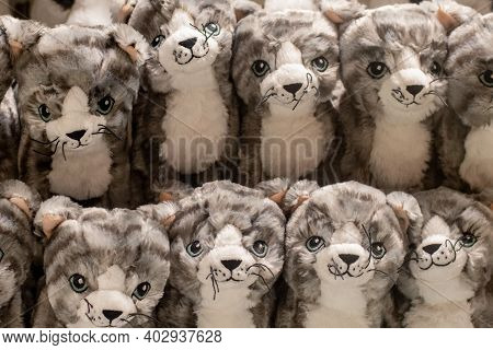 A Lot Of Fluffy Cats Plush Soft Toys Piled Together