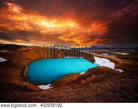 Picturesque view of the lake with azure water in the crater of Krafla volcano. Location place valley Leirhnjukur, Myvatn lake, Iceland. Image of exotic world landmarks. Discover the beauty of earth.