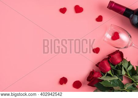 Valentine's Day Dating Gift With Wine And Rose Concept On Pink Background