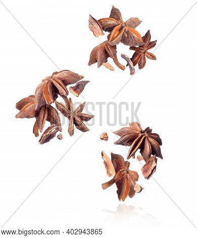 Group Of Crushed Anise In The Air Close-up On A White Background