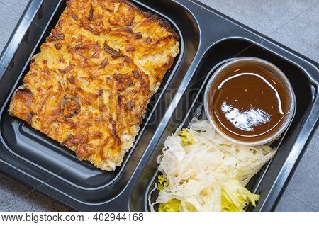 Healthy Takeaway Food In Box. Cabbage Pancake With Potatoes And Bacon With Bbc Sauce