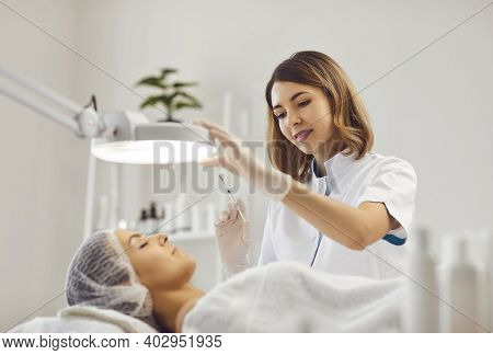 Female Beautician Makes Rejuvenating Injections To A Young Woman In A Modern Beauty Salon.