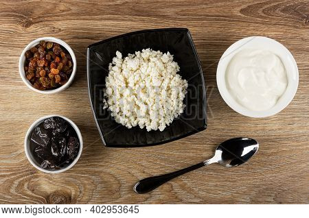 Bowls With Raisin And Prune, Black Glass Bowl With Defatted Grainy Cottage Cheese, Bowl With Sour Cr