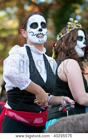 Zombie Woman Tosses Candy To Crowd At Halloween Parade