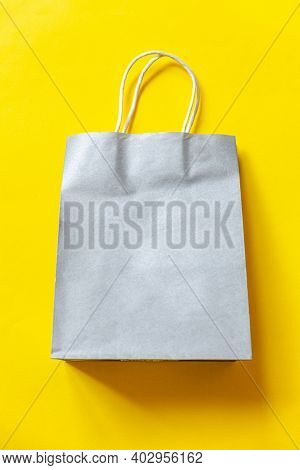 Simply Minimal Design Shopping Bag Isolated On Yellow Background. Online Or Mall Shopping Shopaholic