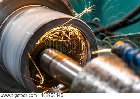 Grinding And Processing A Part On A Grinding Machine At A Manufacturing Enterprise, Sparks From The