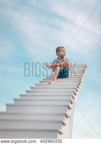 Little boy on the stairs to sky