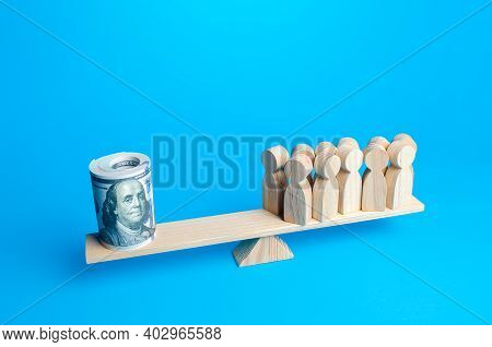 A Group Of People And A Bundle Of Dollars On The Scales. Financial Support In A Difficult Economic S