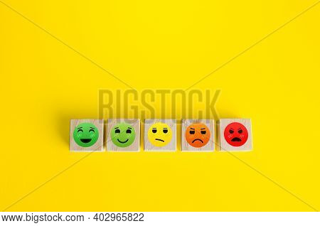 Mood Faces From Happy To Angry On Wooden Blocks. Concept Of Rating, Review. Visitor Satisfaction Wit