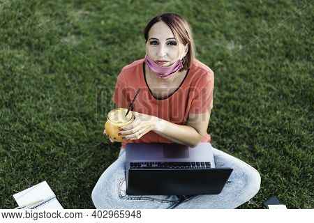 Woman 40 Years Old Working Outdoors With Laptop During Coronavirus Outbreak - Smiling Female Entrepr