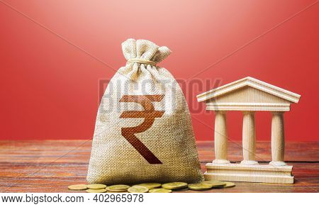 Indian Rupee Money Bag And Bank / Government Building. Tax Collection And Budgeting. Gdp And Gnp. Mo