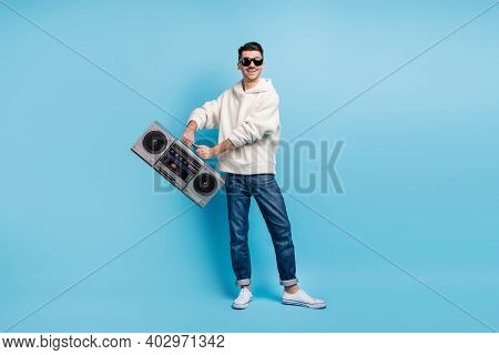 Photo Portrait Full Body View Of Cool Guy With Stubble Swinging Boombox With Two Hands Isolated On P