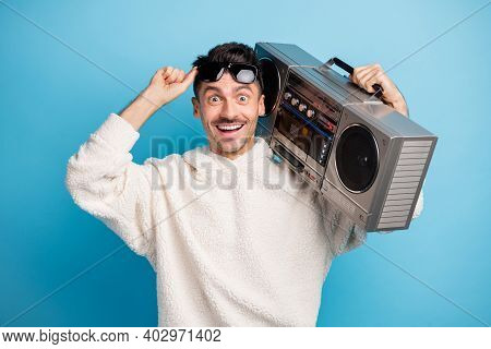 Photo Portrait Of Excited Man With Stubble Lifting Up Glasses Holding Boombox On Shoulder Isolated O