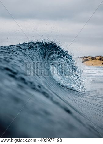 Crashing Glassy Wave On The Sandy Beach. Breaking Ocean Wave, Perfect Swell For Surfing