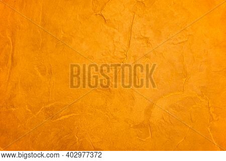 The Orange Cement Wall Background Surface Is Not Smooth, But With Softness. Gold Color Wall Backgrou