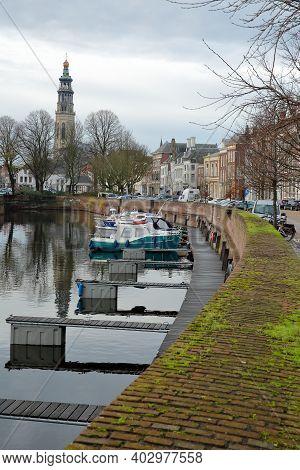 Reflections Of Abdijtoren De Lange Jan (long John Abbey Tower) Viewed From Dam Street In Middelburg,