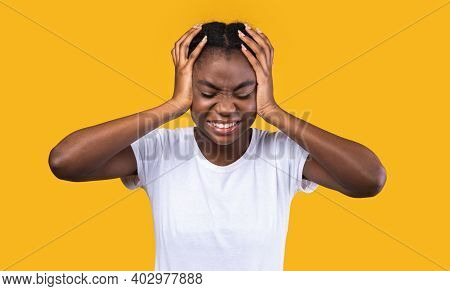 Headache. Black Young Lady Touching Aching Head Suffering From Pain And Severe Migraine Standing Pos