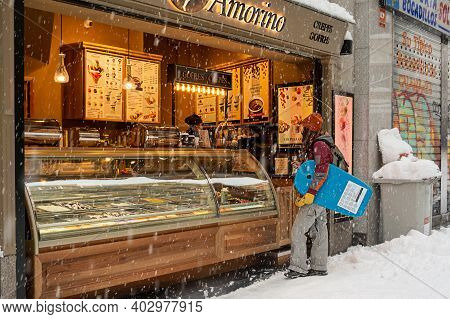 Madrid, Spain, 01.09.2021, Snow Covered Street Postas, A Young Woman Buying A Coffee In Madrid Cente