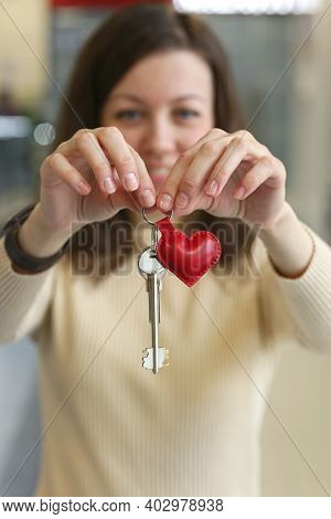 Happy Young Woman With Leather Red Heart Key Trinket As A Valentines Day Gift Close Up Photo
