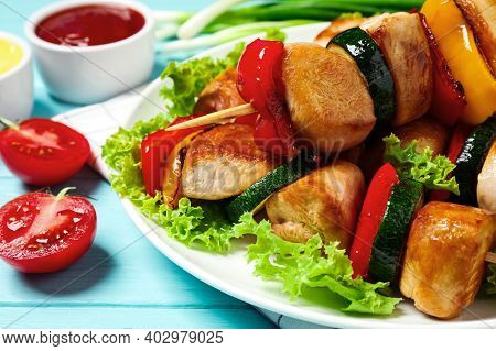 Delicious Chicken Shish Kebabs With Vegetables On Light Blue Wooden Table, Closeup
