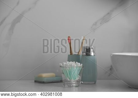 Cotton Buds And Toiletries On White Countertop