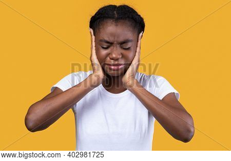 Too Loud. African American Woman Covering Ears Suffering From Otitis Having Ear Problems Standing Wi